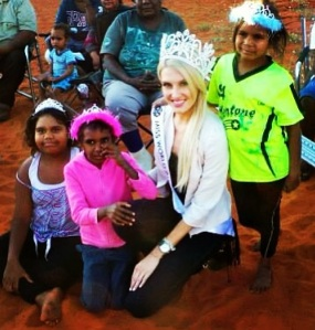Beauty with a Purpose.  Erin with the kids of Lilla Community